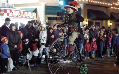 Christmas parade participant on a unicycle