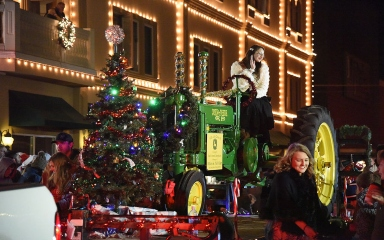 John Deere tractor on a Christmas parade float