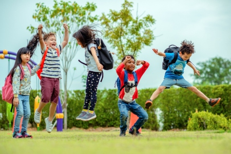 kids enjoy and happy jumping on the field of playground