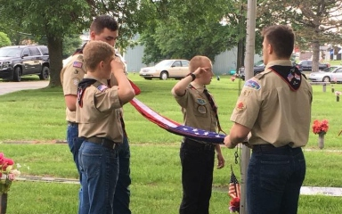 Boy Scouts folding flag